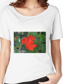 Red powerful color flower and green leaves background. Women's Relaxed Fit T-Shirt
