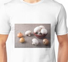 Raw champignon mushrooms and onions on the table Unisex T-Shirt