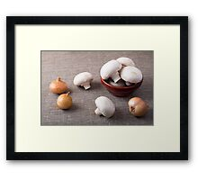 Raw champignon mushrooms and onions on the table Framed Print