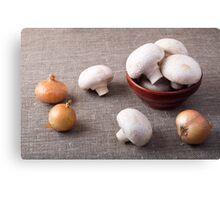 Raw champignon mushrooms and onions on the table Canvas Print