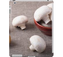 Raw champignon mushrooms and onions on the table iPad Case/Skin