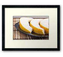 Juicy yellow melon on wooden background Framed Print
