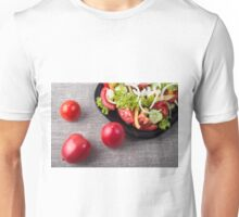 Close-Up top view fresh tomatoes and a part of a plate with vegetarian salad Unisex T-Shirt