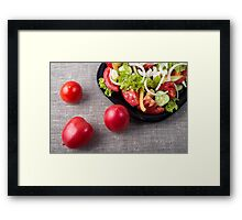 Close-Up top view fresh tomatoes and a part of a plate with vegetarian salad Framed Print