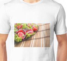 Close-up view of the tabletop and a plate of fresh  salad Unisex T-Shirt