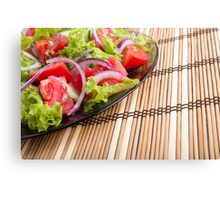 Close-up view of the tabletop and a plate of fresh  salad Canvas Print