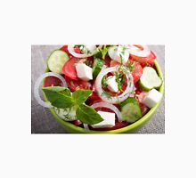 View close-up on a green bowl with a salad Unisex T-Shirt