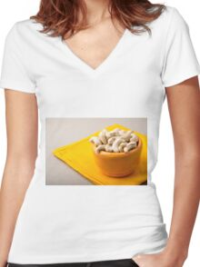 Selective focus on raw cashew nuts in a small orange cup Women's Fitted V-Neck T-Shirt
