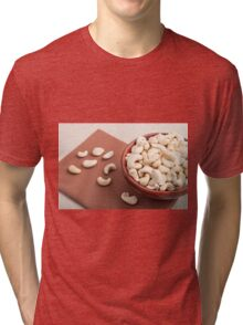 Close Up view on raw cashew nuts for vegetarian food Tri-blend T-Shirt