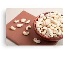 Close Up view on raw cashew nuts for vegetarian food Canvas Print