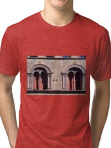 Building facade with two windows with arcades from Bologna. Tri-blend T-Shirt