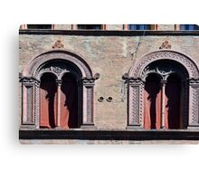Building facade with two windows with arcades from Bologna. Canvas Print