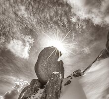 Snow, rock, sky, Mount Buffalo by Kevin McGennan