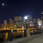 City lights and the moon by Sven Brogren