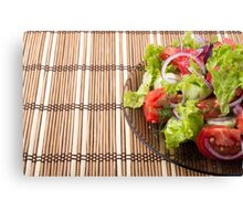 Vegetarian salad from fresh vegetables on a bamboo mat Canvas Print
