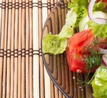 Vegetarian salad from fresh vegetables on a bamboo mat Sticker