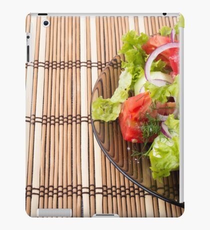 Vegetarian salad from fresh vegetables on a bamboo mat iPad Case/Skin