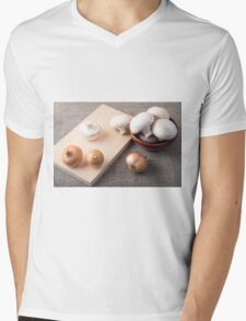 Raw champignon mushrooms and onions on the tabletop Mens V-Neck T-Shirt