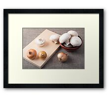 Raw champignon mushrooms and onions on the tabletop Framed Print