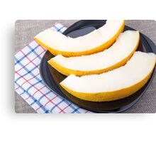 Dessert of sweet yellow melon slices Canvas Print