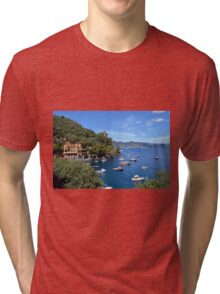 6 August 2016. Photography of the beautiful Portofino fishing village in Italy. View on small bay and colorful houses at town of Portofino in Liguria, Italy. Tri-blend T-Shirt