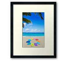 Color flip flops and drawing sun on sandy beach Framed Print