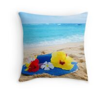 Woman's hat with tropical flowers on sandy beach Throw Pillow