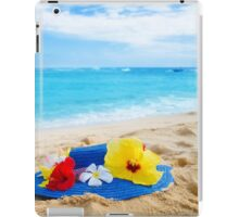 Woman's hat with tropical flowers on sandy beach iPad Case/Skin