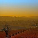 Haze, sunset and city skyline   landscape photography by Patrick Jobst