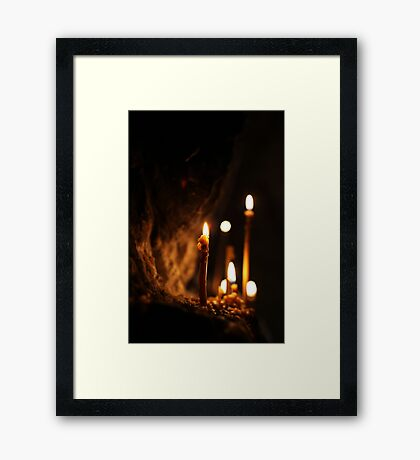 Candle in the dark Framed Print