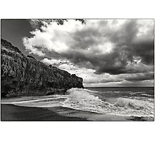 Rocks on a stormy sea Photographic Print