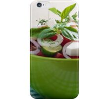 Green bowl with vegetable salad  on a green checkered tablecloth iPhone Case/Skin