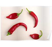 Hot chili peppers on a light wooden board Poster
