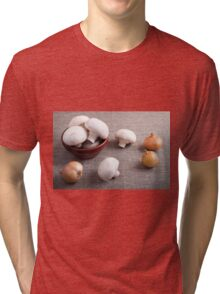 Champignon mushrooms and onions on the table Tri-blend T-Shirt