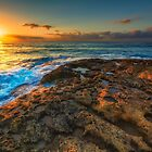 Sunrise and rocky shore by Ralph Goldsmith
