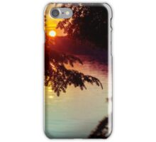 setting sun shining through the trees and reflecting off a northern lake iPhone Case/Skin