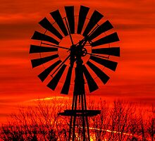 Midwestern Windmill Sunrise Silhouette by Kenneth Keifer