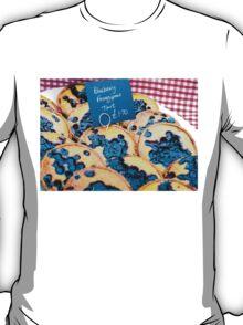 Delicious round blueberry tarts in British market T-Shirt