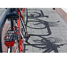 Bicycle shadow on the ground. Photographic Print