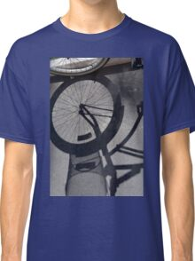 Bicycle shadow on the ground. Classic T-Shirt