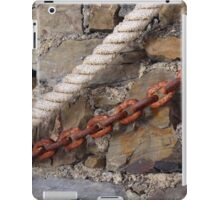 Rope and metal chain on grungy stone wall. iPad Case/Skin
