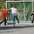 Playing football with dad. Summer evening. by UpNorthPhoto