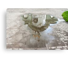 church reflected in a puddle Canvas Print
