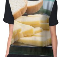 Cut slices of cheese on a plate close-up Chiffon Top