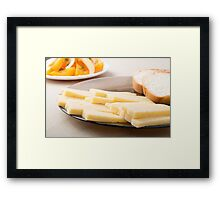 Slices of cheese and bread on a plate closeup Framed Print
