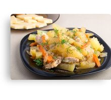 Dish of stewed potatoes with meat and spices Canvas Print