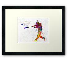 Baseball player hitting a ball Framed Print