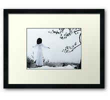 Woman standing on a cliff with spread hands embracing the world art photo print Framed Print