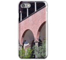 Building with red brick facade and arches in Siena. iPhone Case/Skin