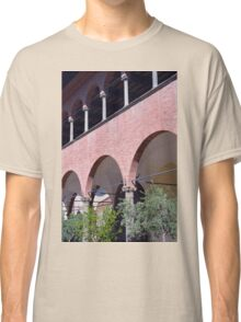 Building with red brick facade and arches in Siena. Classic T-Shirt